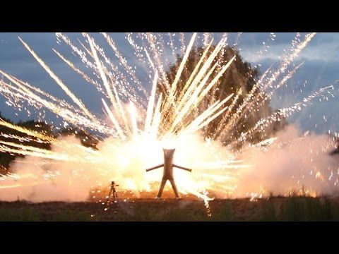 Inventor Builds a Giant Steel Suit and Stands Inside a Fireworks Display