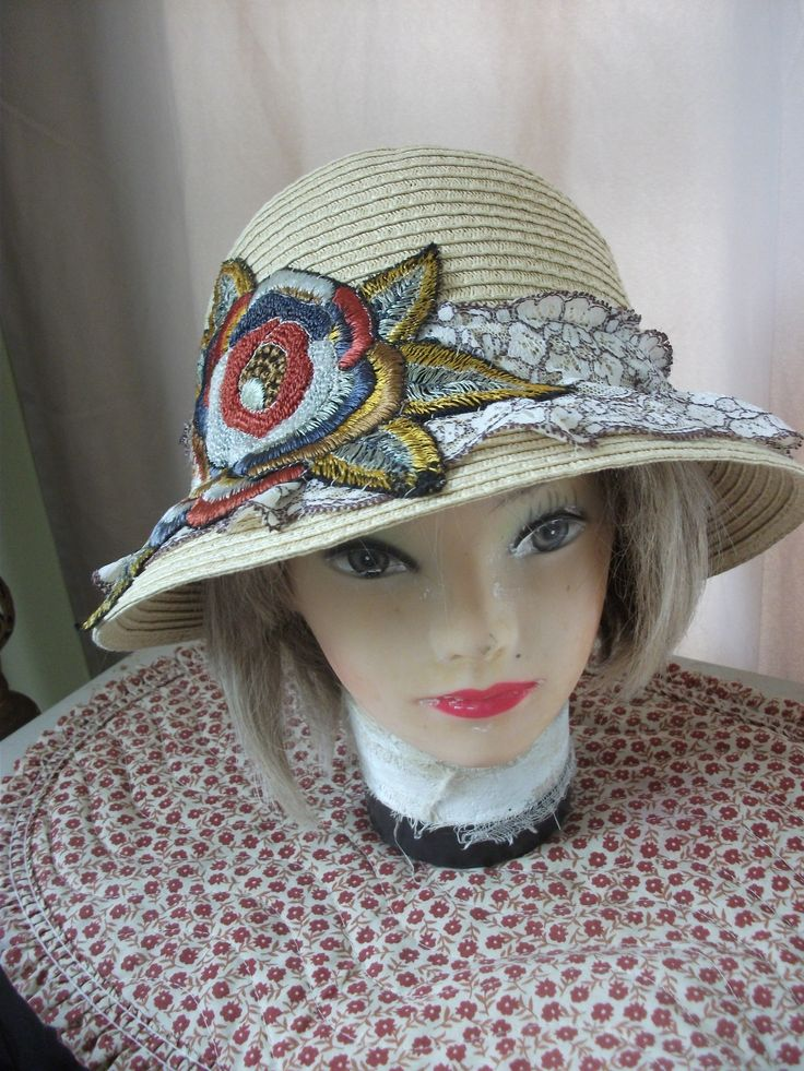 Looks like straw but says its 'paper'! Added embroidered motif.