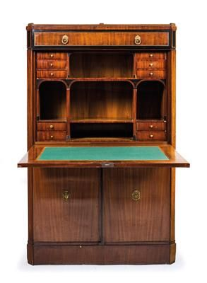 Neo-Classical fall-front desk, in what is known as the Metternich style, Vienna, ca. 1790/1800. A mahogany-veneered softwood desk with lightly moulded cornice and plinth, with ebony veneer contouring, a cornice drawer, fall front with gilt mounts, a fitted interior with 10 interior drawers and compartments, a lower section with 2 doors and a mahogany-veneered fitted interior, a plinth drawer and gilt mounts. Wien, Dorotheum, 22.04.15, no. 552.