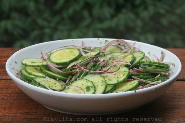 Easy and delicious cucumber salad recipe made with sliced cucumbers and red onions marinated with a lime cilantro dressing.