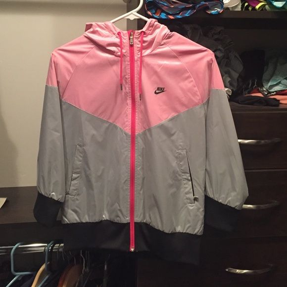 Pink, gray, and black nike waterproof jacket. I received this as a birthday present but haven't worn it. Great for going to and from workouts or just wearing it on a lazy day. A total steal (: Nike Jackets & Coats