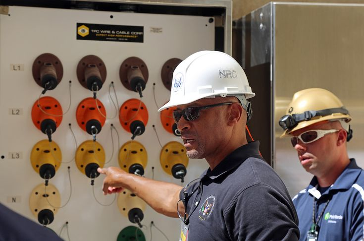 NRC Executive Director for Operations Vic McCree notes the electrical connections for portable FLEX diesel generators during a recent tour of the Palo Verde Nuclear Generating Station in Arizona. The connections are part of NRC requirements imposed after Fukushima, which require each plant to have diverse and flexible means of restoring power to vital equipment in an emergency.  Visit the Nuclear Regulatory Commission's website at www.nrc.gov/.  To comment on this photo go to public-...