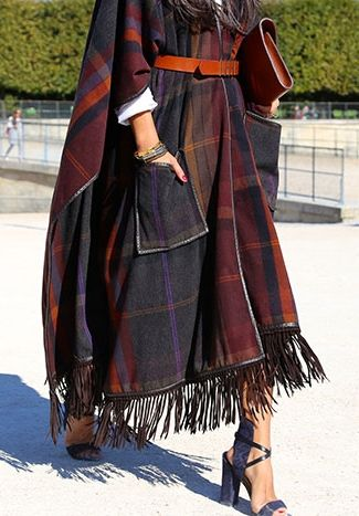 Spotted at Paris Fashion Week: a plaid cape with fringe detail paired perfectly with chic strappy heels.