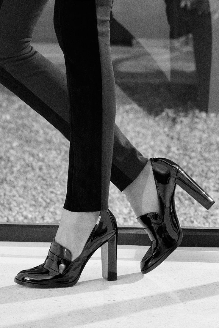 Borrowed from the boys. The Kathryn patent leather loafer features an iconic shape updated with a high heel.
