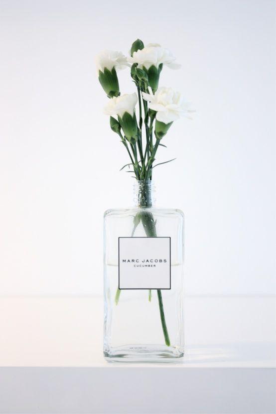 Flowers in an old perfume bottle