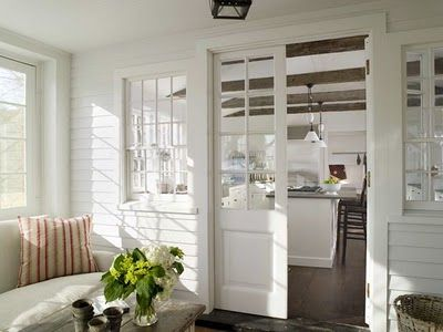 doors with glass to seperate rooms within the house, keeps an open feel but seperates if needed. would be great to close of formal rooms from kiddies