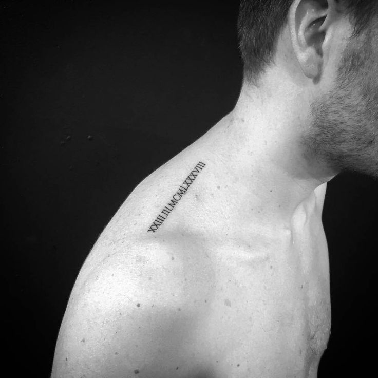 Date in roman numerals tattoo on top of the right shoulder. Tattoo artist: ShortyLoco