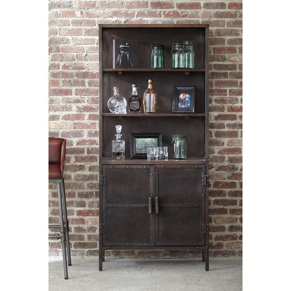 Providing abundant storage and display space, the Highway to Home Recording Studio Bookcase provides function and style, with a touch of music inspired whimsy. Microphone-door handles create a fun element while mesh screen door fronts and metal detailing create an industrial look.