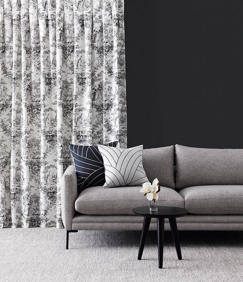 Toile de Jouy from James Dunlop is a decorating pattern that was introduced in France in the 18th Century. The Loire collection is a more classical reference to this; featured as curtains, it's set in front of a wall in Resene Foundry.