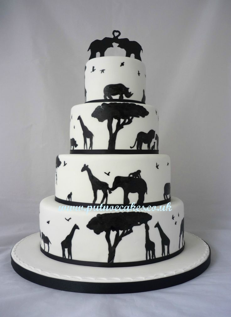 This is beautiful! definitely loving the animal silhouette theme. That cake topper is adorable!