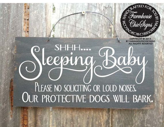 Shh....Baby Sleeping, our protective dogs will bark. This sign is hand painted to look rustic on 6x 12 outdoor plywood and comes with a wire