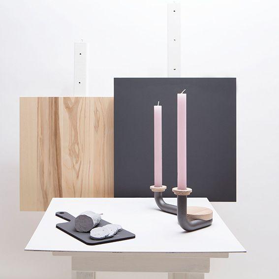 Roze kaarsen in deze mooie kandelaar.  Candle holder - Around the Block - Coal // Wood - Van Tjalle en Jasper