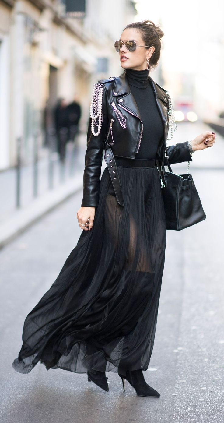 ALESSANDRA AMBROSIO Snapped out and about in Paris, VS Angel Alessandra Ambrosio demoed how to winter-proof a sheer black maxi skirt: with a black turtleneck, a badass chain- and pearl-embellished moto jacket, and over-the-knee boots. To complete the look, the supermodel finished with mirrored aviators, silver drop earrings, and a classic Birkin. Model off-duty perfection.