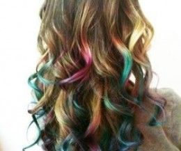 It's called hair chalking. You don't have to even die your hair! You just buy some chalk & your favorite colors you like and DIY. Look it up on youtube. If you can't find it, get at me so I can get you in the right direction for it. (: