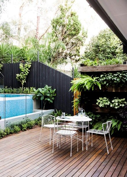 The deck is spotted gum coated in clear decking oil. A 'Tidal' powder-coated steel outdoor table and chairs from Tait creates a stylish and functional focal point | Home Beautiful Magazine Australia