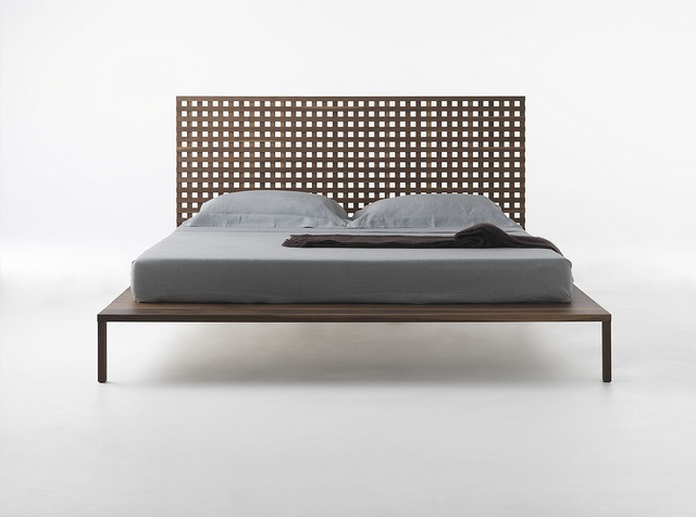 Twine / Design: Matteo Thun & Antonio Rodriguez, 2011 / Completely made of solid walnut, Twine features a headboard made of orthogonal slats that creates a fine yet distinctive fretwork. The craftsmanship that enhances the clean design lines constitutes an essential element of this bed.