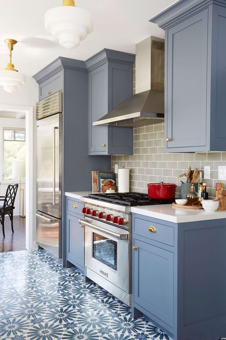 good Blue Kitchen Cabinets #7: Benjamin Moore Wolf Gray a blue-grey painted kitchen cabinets with  patterned floor tile and