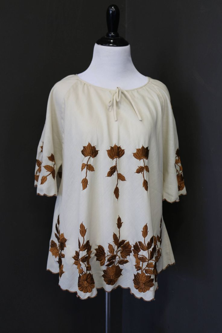 A personal favorite from my Etsy shop https://www.etsy.com/listing/529727661/70s-floral-embroidered-topblouse