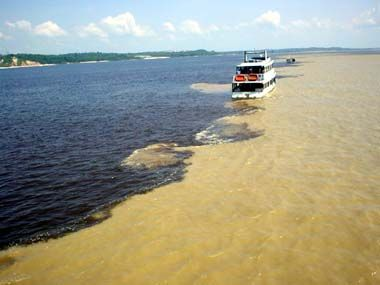 My place I - the meeting of rivers who do not mix (Black River and Amazon River/Solimoes) - nearby Manaus, Amazonas, Brazil