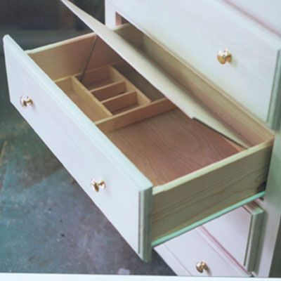 build jewelry storage into a drawer...does not even need to be hidden!