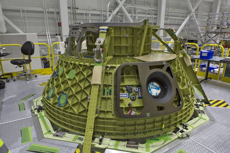 https://flic.kr/p/21R8x96   KSC-20171030-PH_KLS01_0049   The upper dome of Boeing's CST-100 Starliner Crew Test Flight Vehicle is undergoing processing inside the company's Commercial Crew and Cargo Processing Facility at NASA's Kennedy Space Center in Florida. The Starliner will launch astronauts on a United Launch Alliance Atlas V rocket to the International Space Station as part of NASA's Commercial Crew Program.  Photo credit: NASA/Kim Shiflett NASA image use policy.