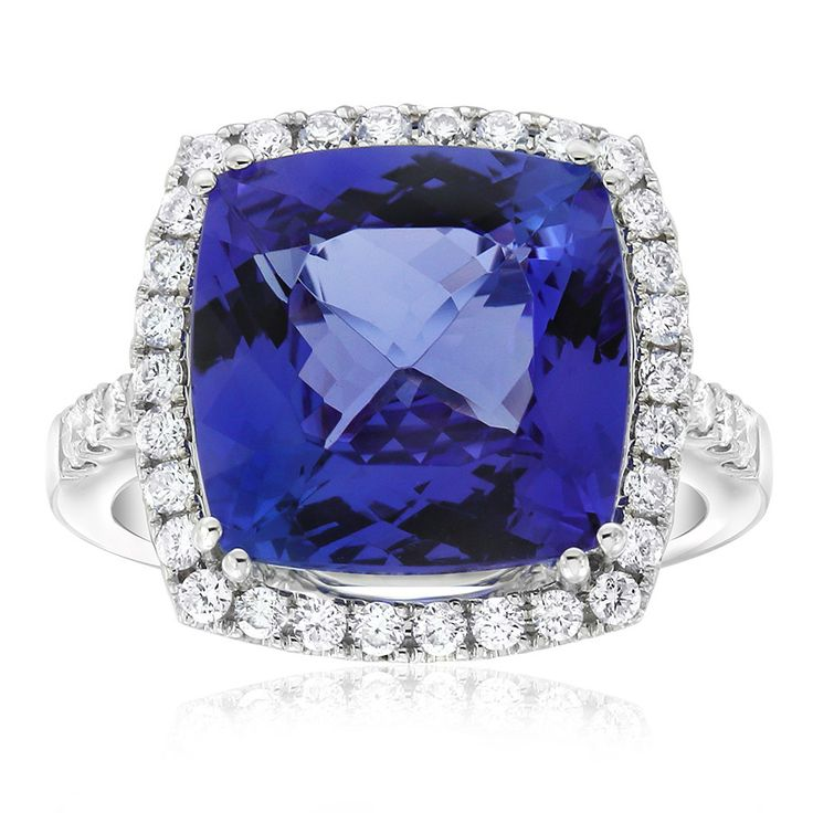 Rare and beautiful. Kilimanjaro tanzanite and diamond dress ring. This cushion shape tanzanite weighs 7.22carats and is a deep purple-blue colour. Crafted in 18ct white gold. This ring will be customised to perfectly fit your finger, which may take up to 6 weeks