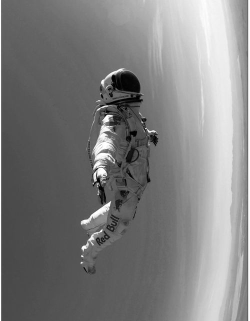 spaced spaceman/astronaut.  red bull jump moment of sublime calm captured