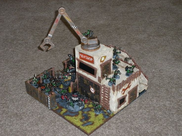 Hi all, Here's a Mek Shop I designed and then made for our Warhammer 40k Games. I've always wanted to make some orky terrain and this is my...
