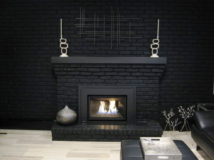 black brick fireplace - black TV above it on black so that if TV isn't on, it blends in.