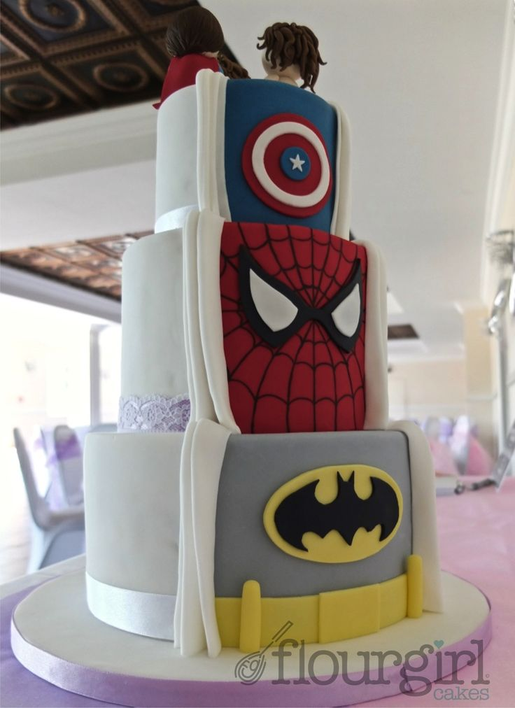 Secret Superhero Wedding Cake. What a terrific idea, reminds me of superman pulling his shirt open