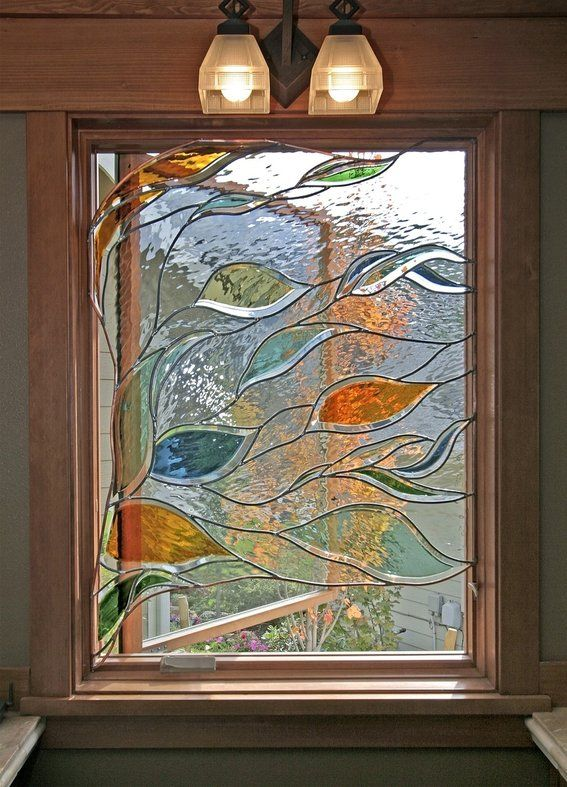 Stained glass window in bathroom depicting blowing branches and leaves: beautiful but not affordable from this artist. Description from pinterest.com. I searched for this on bing.com/images