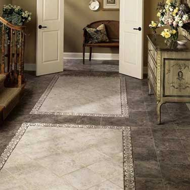 floor features travata 12 x 12 in colors chocolate mousse and fresco cream with coordinating tumbled natural stone 4 x 10 scroll mosaic in color marfil - Floor Design Ideas