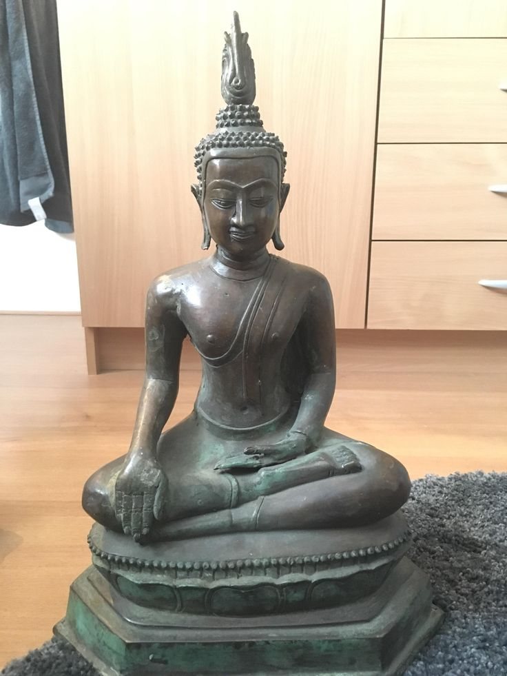 Can someone tell me more about this bronze buddha statue that I got as a present? It's from Thailand