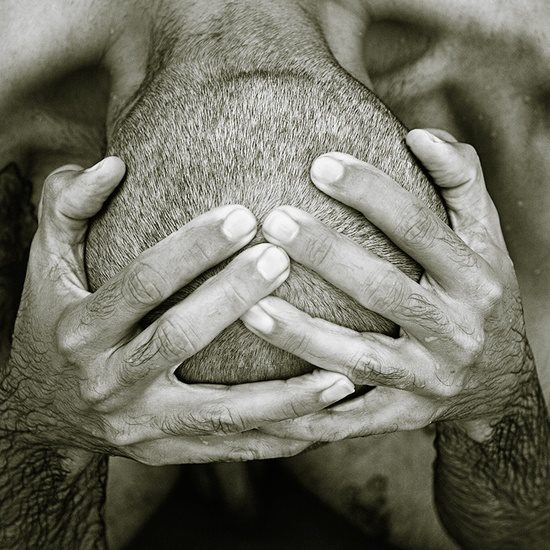 Powerful expression, dispair, hands, fingers, hurt, pain, strong image, photo b/w.