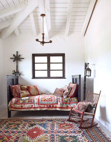 Guest Bedroom, A Suzani quilt and kilim pillows give the guest room's Spanish Colonial-style daybed a dose of global pizzazz. The lantern is an early California cowboy lamp.