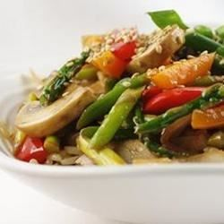 Asparagus, red bell pepper, onion, mushrooms, ginger and garlic stir-fried in peanut oil and garnished with toasted sesame seeds.  Serve over rice.