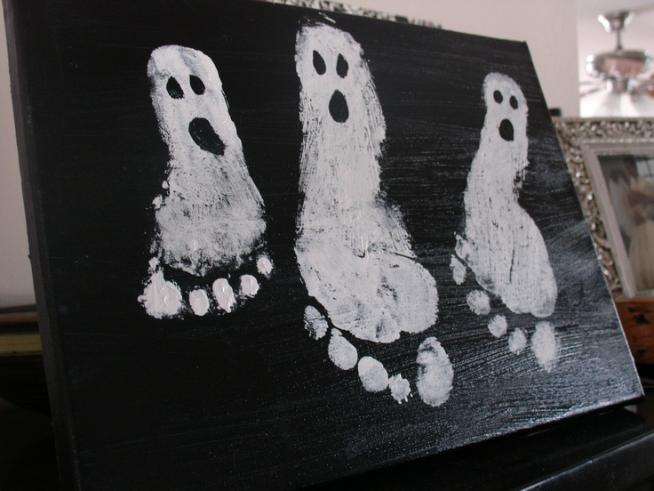 OMG I love these ghosts!  Could use a larger canvas and add to it each year as kids' feet grow:)