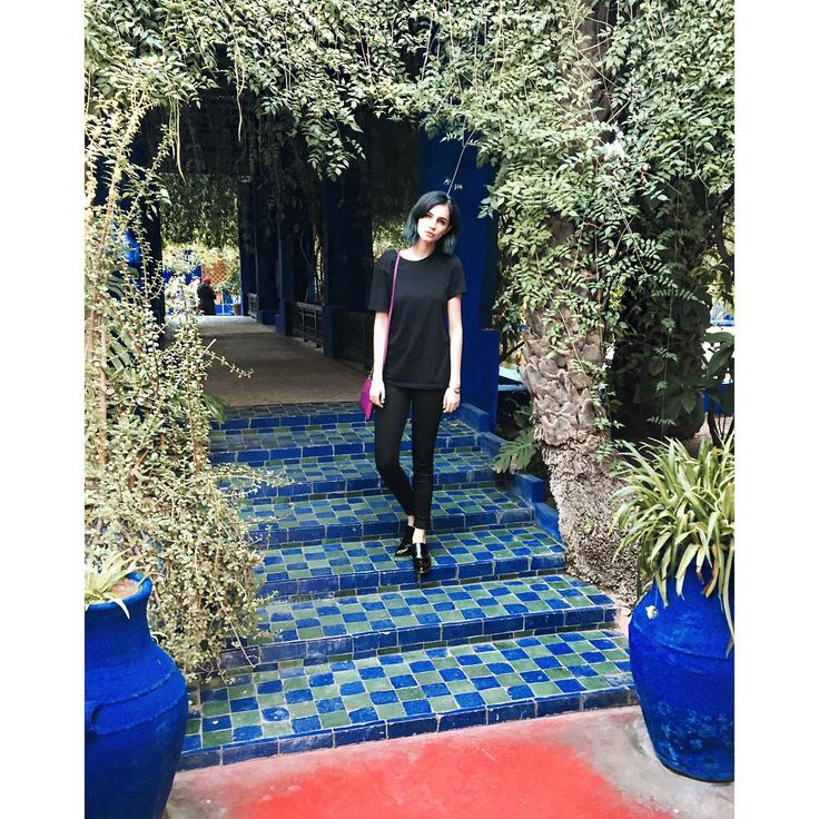 Nikita Andrianova wearing ZURBANO Black Loafers on colorful Marrakesh street