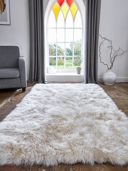 This large long wool sheepskin rug creates a rustic or modern style depending on the chosen decor!
