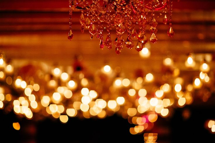 Glamorous chandelier standing out at the wedding party lighting up the dancefloor!