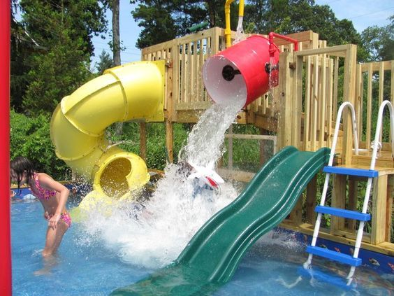 Look at this fabulous backyard water park that my husband (I mean my 3rd child) custom built in our backyard!!! It has a dump bucket, slides, water cannons, a kiddie section, squirting palm tree, and more! The water is chlorinated and recirculates.  This is not a pool....this is not a splash pad....it's one of a kind!!! It is the first ever residential waterpark!!! It was not expensive to build either. Probably about the same as an above ground pool.: