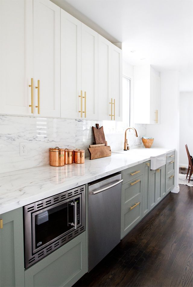 I am in love with this kitchen.  The white top cabinets, the gray/green bottom cabinets and gold hardware are a perfect combination!! I currently have dark countertops but these are really calling my name.