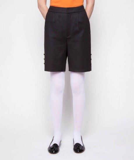 Front pleat shorts crafted in a winter weight wool blend fabric with a hint of elastane. Cut with a high waist, two curved pockets, a concealed zip fastening and decorative three button detail on the side of the leg. Finished with a self colour Laurel Wre