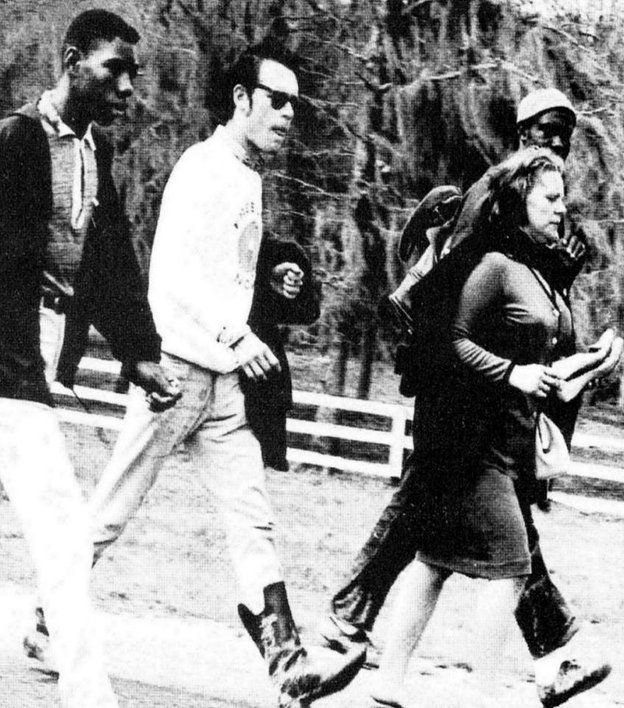Viola Liuzzo carries her shoes while walking with other civil rights activist before she was shot and killed in Alabama.