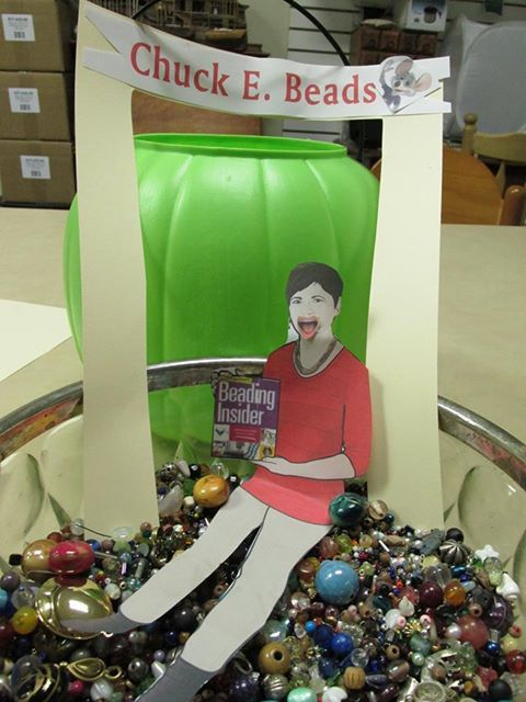 This photo was taken 10/18 at Thistle Bead's carnival night. Flat Cathy had fun playing in all the beads!