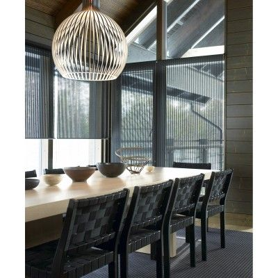 Sunscreen Roller Blinds In This Dining Room Show How You Can Still See Out  When The Blinds Are Down.