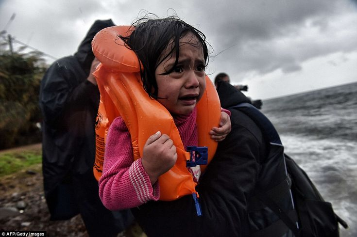 Refugees and migrants arrive at Lesbos island after crossing the Aegean sea from Turkey