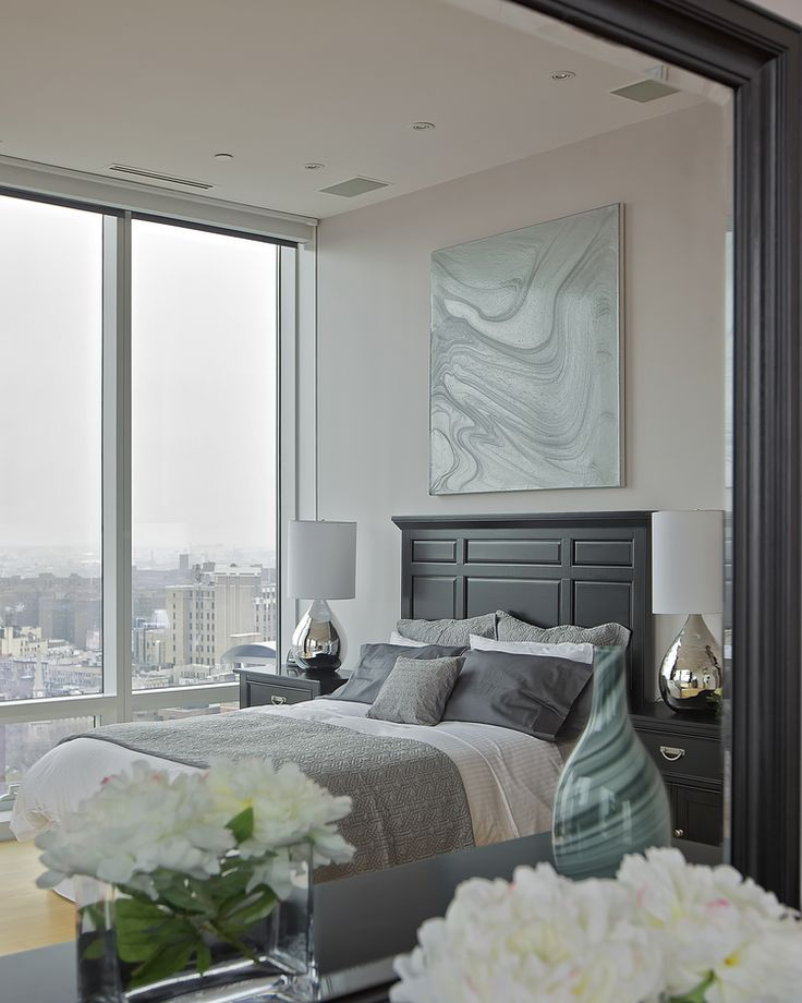 CONTEMPORARY LAMPS AND SWEEPING VIEWS IN A MARIE BURGOS PENTHOUSE