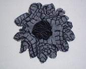 Light grey felt flower brooch with thick black silk thread