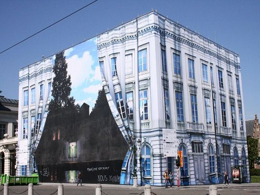 """""""Back in 2009, a new museum, dedicated to the Belgian surrealist painter René Magritte, opened in Brussels. The building that housed this famous painter's work had its facade recreated in trompe l'oeil, featuring two side of theatre curtains pleated open to reveal a giant reproduction of iconic work of Magritte: The Empire of Light (1954)."""""""
